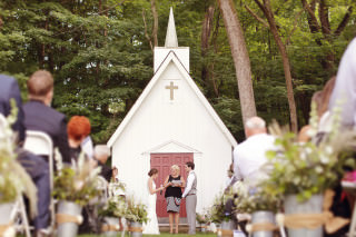 a wedding ceremony at the chapel at rockmill brewery in lancaster ohio.