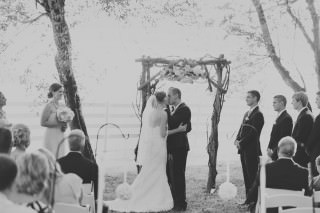 The bride and groom share their first kiss at the Irongate Equestrian Center during their wedding ceremony.